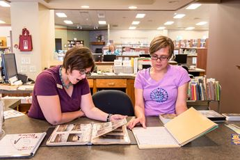 Library employees working on photo preservation project.