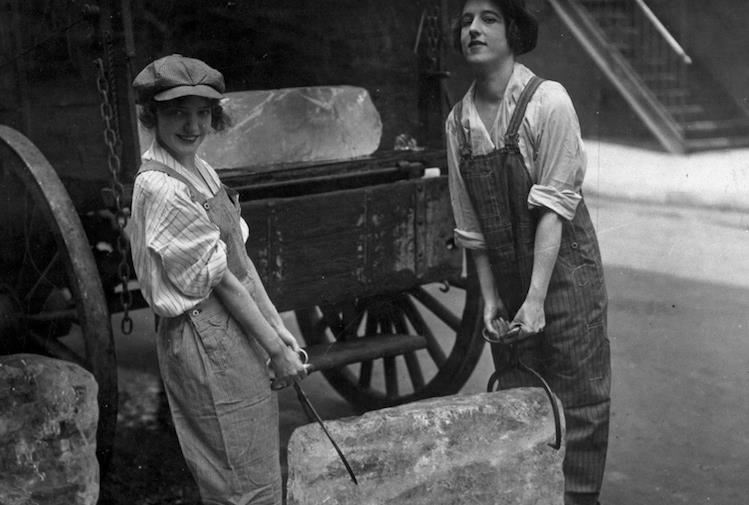 Historical photo of two young women carrying ice