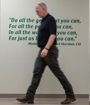 jason wesco walking in front of quote