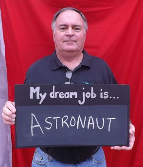 Man holding sign that says My Dream Job is Astronaut