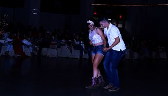 Young woman and young man dance
