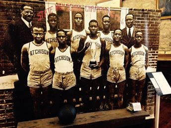 banner featuring African American basketball team in mid-1900s