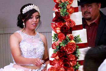 Cutting the cake at Quinceanera