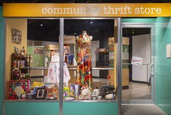 exhibition entrance that looks like a thrift store window