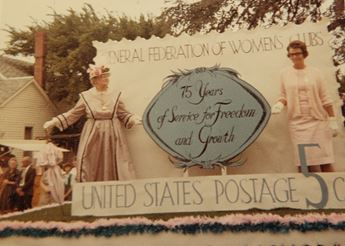 Two women standing on a parade float