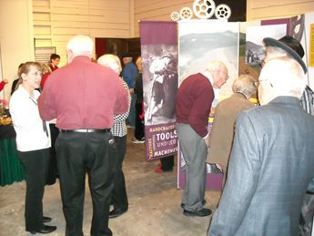 People visiting museum exhibition