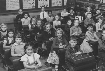 classroom full of children in the 1950s
