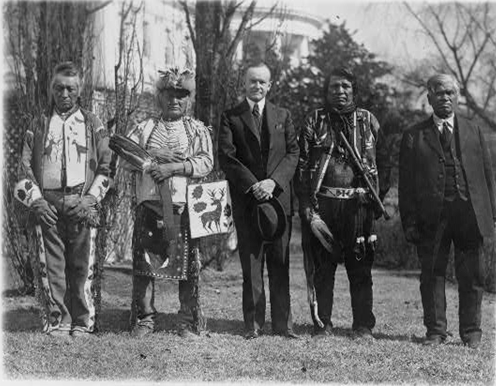 President Coolidge and Native American leaders at White House